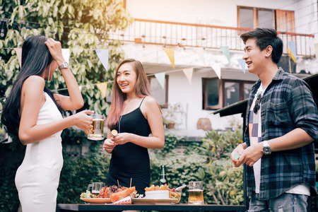 Asian people enjoy party together on weekend in garden.
