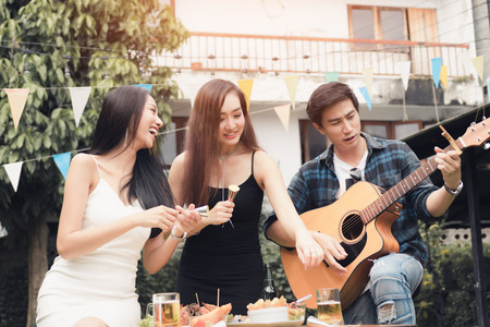 Teenagers are having fun together and celebrate the festival.