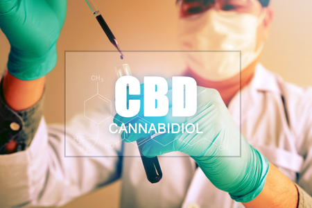 Cannabis oil, CBD concept, Chemist conducts experiments by synthesising compounds with using dropper in a test tube. 스톡 콘텐츠