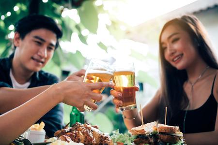 Group of asian people cheering beer at restaurant happy hour in restaurant. Banco de Imagens - 124607150