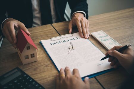 Real estate agent discussion about signing on paper financial contract at office agency.