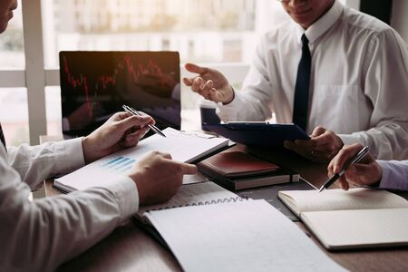 Group of business people analysis summary graph reports of business operating expenses and work data about the companys financial statements.