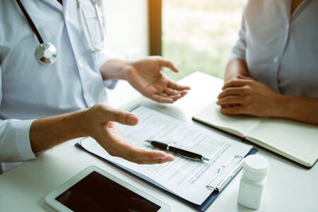 Doctor is explaining the treatment about the possible treatment of patients in the future. Фото со стока