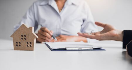 Home agents are sending pens to customers signing a contract to buy a new home. Stock fotó