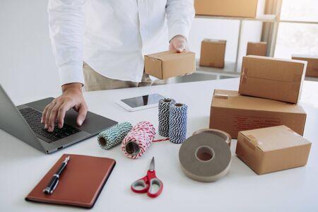 Start up small business owner entrepreneur SME, using laptop for online business in office room.