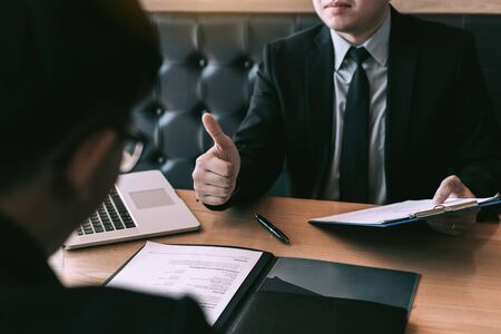 Job interviewer give a thumbs-up for job applications for new employee in the office room. Stockfoto