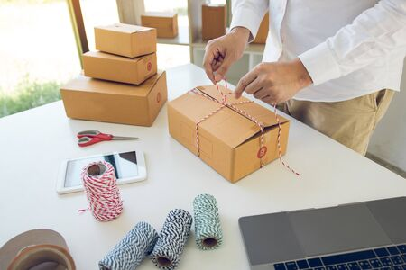 Young asian teenage product owners are packing small business packaging products in boxes prepared for shipping.