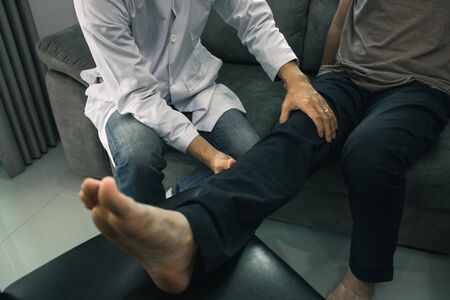 Physiotherapists are using the hands to grip the patient thigh to check for pain and massage in the clinic.