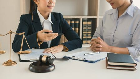 Woman judge is currently advising clients on their requests for legal proceedings and legal advice. Stock Photo