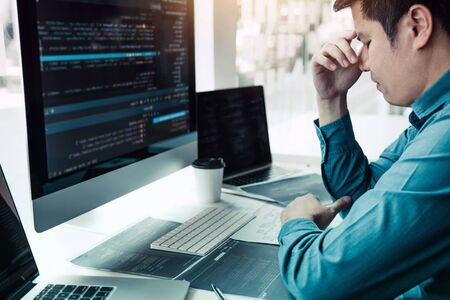Software developers headache with code analysis in the office.