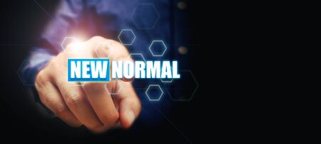 New normal concept with finger man pointing text with the concept after the virus epidemic. Stok Fotoğraf