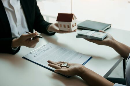 Home agents are sending pens to customers signing a contract to buy a new home. Reklamní fotografie