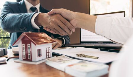 Home sales agents and buyers work on signing new homes and shaking hands. Reklamní fotografie