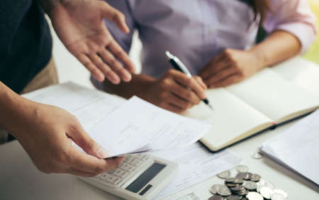 Two asian couples and men and women are together analyzing expenses or finances in deposit accounts and daily income sources with an savings economical concept.
