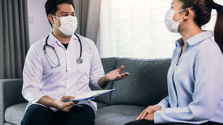Doctor visited the patient while wearing a mask at home to check the patient treatment during the virus epidemic.