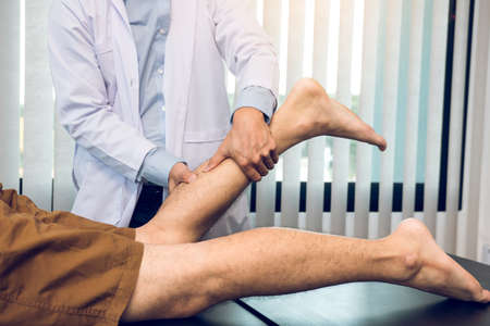Physical therapists use their hands to check the calf muscles.