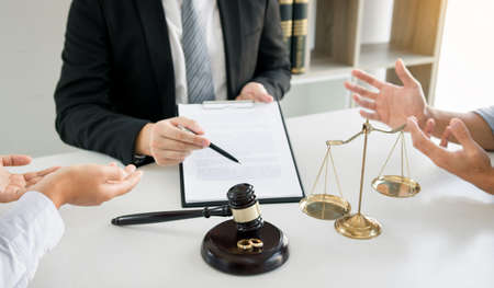 Couples are arguing in a poignant mood in the divorce process while the lawyer is explaining the law at the office.