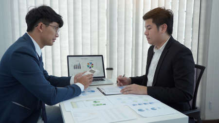 Teamwork with business people analysis cost graph on desk at meeting room. 版權商用圖片
