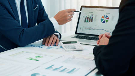 Group of business people analysis summary graph reports of business operating expenses and work data about the company's financial statements.