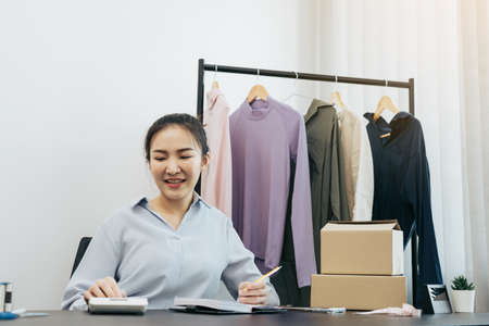 Young asian entrepreneurs are working and smiling.