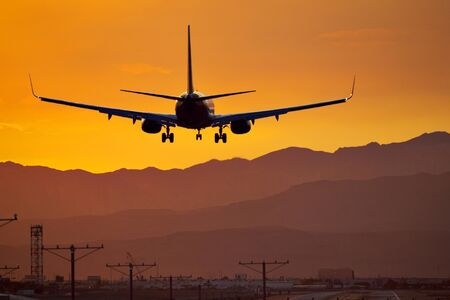 Silhouette of Commercial Airliner landing in Las Vegas at Sunset
