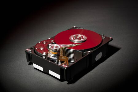 Opened and Exposed Hard Drive Platters in Red