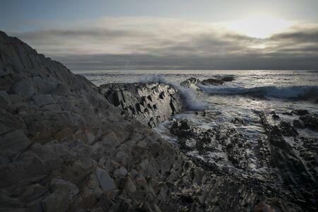 Ocean Waves Crashing on Jagged Rocks in Southern California