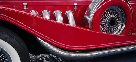 Classic Red Roadster Exhaust and Spare tire