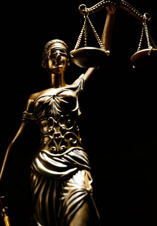 Bronze Themis statue - symbol of Justice - Isolated on black