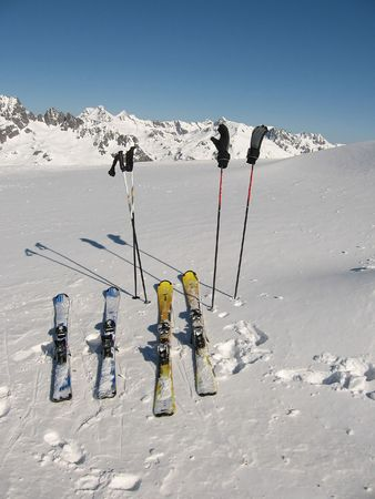 wintersport: Lonely skis on a sunny day at Wintersport Les Sybelles France