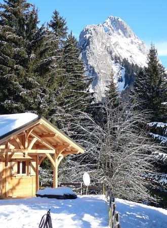 French chalet with mountains on the background. Location Bernex, France photo