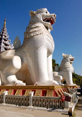 MANDALAY, MYANMAR- DEC 26  the largest white lions or Singhas  This couple lion sit at the front of stair of Mandalay hill Dec 26, 2009 in Mandalay, Myanmar  Burma   Stock Photo - 15156857