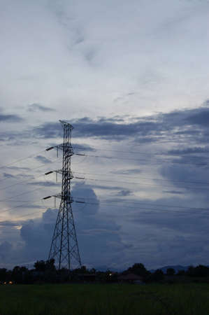 The Pylon deliver high voltage electricity on the cloudy sky  Stock Photo - 15291477