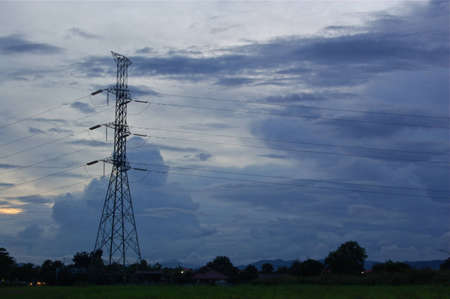 The Pylon deliver high voltage electricity on the cloudy sky  Stock Photo