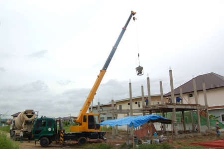 The basket of concrete was deliver to construction site by crane truck  Stock Photo - 16421312