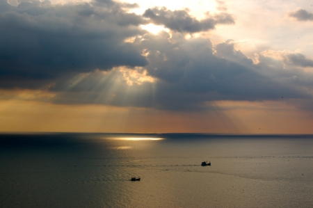 The fisherman ship run pass sunset in Phuket, Thailand photo