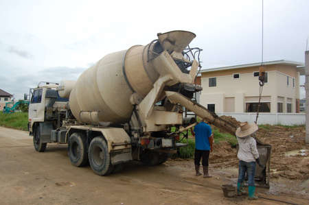 The mixer truck is on duty in construction site