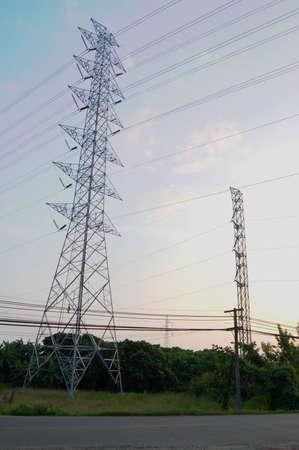 Huge pylon transfer high voltage electric front of blue sky background