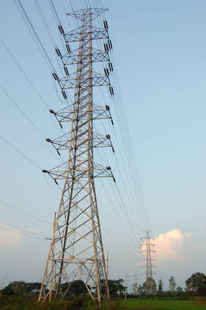 Huge pylon transfer high voltage electric front of blue sky background photo