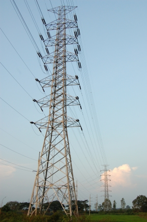 Huge pylon transfer high voltage electric front of blue sky background