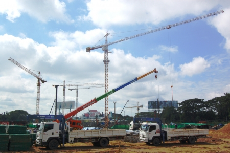 Big cranes is used at big building construction site. Editorial