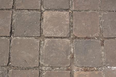 ancient red clay square brick floor in Sukhothai, Thailand