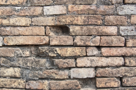 The old brown red brick wall in ancient building of Sukhothai, Thailand