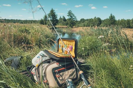 Minsk region. Belarus - May 26, 2019: baits of the SVFishing brand, spinning of the brand Gloomis. Bag brand Simms. Box for baits brand Favorite. Banco de Imagens