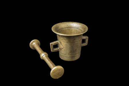 Mortar for spices on a black background 版權商用圖片