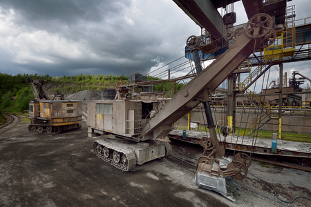 slag: Trinec, Czech Republic - May 12, 2014: mining excavator in the iron slag on the economy