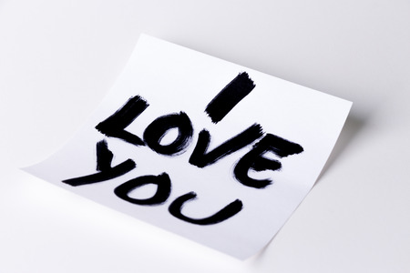 i love you sign: I love you card on a white background, studio isolated