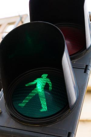 pedestrian crossing: Green light at pedestrian crossing lights, closeup