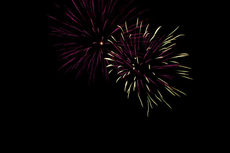 Festive and colorful fireworks against a black background - 5 Stock Photo