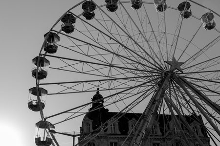 Ferris wheel silhouette in black and white at a local French market